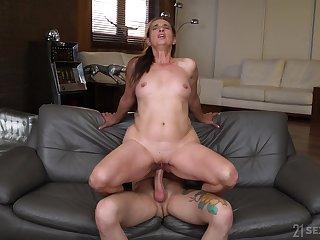 Mature rides the big ail like she's 18 again