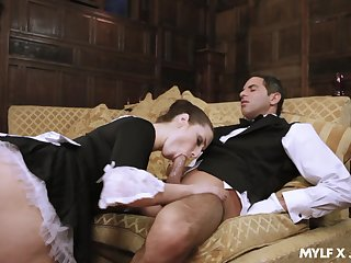 Naughty maid Paige Turnah gives a blowjob to horny boots