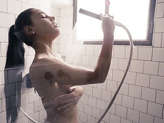 Captivating beauty Apolonia is masturbating pussy in be imparted to murder shower
