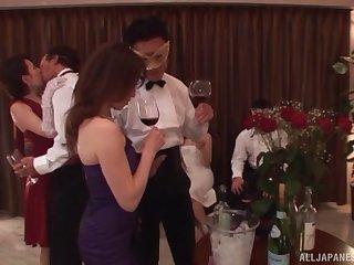 Japanese wife drops on her knees to stand aghast at fucked during a party